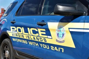 A Virgin Islands Police Department vehicle sits parked in front of the V.I.P.D. (Source photo by Bethaney Lee)