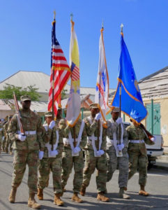 The Color Guard of the USVI Army National Guard carries the flag high. (Source photo by Linda Morland)