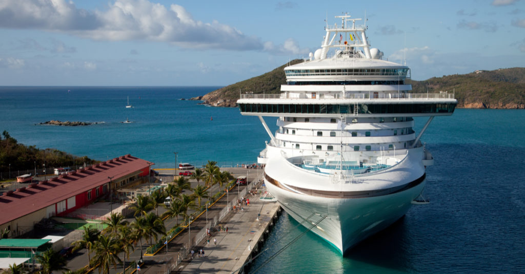 A cruise ship docks at the WICO dock on St. Thomas. During the ongoing Coronavirus pandemic the sight of cruise ships at the pier has become a memory. (Shutterstock)