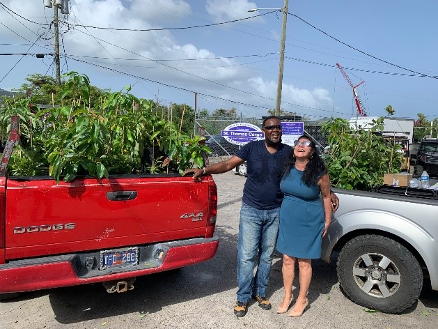 Farmer and volunteer Royce Creque (left) of Green Ridge Guava Berry Farm in Bordeaux on St Thomas and Christina Chanes (right) who is the CGTC program coordinator of the UVI project worked together to give fruit trees to 100 farmers and 250 families across the USVI for increased food security. UVI's Agriculture Experiment Station (AES) staff helped to support the project assisting with distribution on St. Croix.
